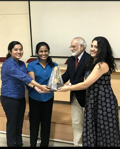 The winners of the Best Team and the Best Speaker prize, Ayushi Halder and Swathi Satish from St. Mira's College with the judges, Mr. Suraj Sriram and Ms. Priyanka Menon.