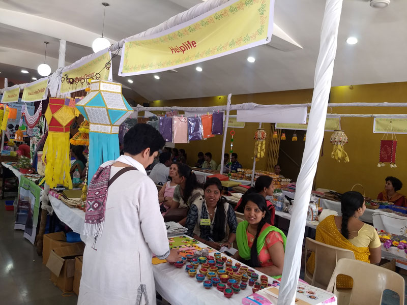 Students and Helplife boarders enthusiastically selling products at Srujan - II
