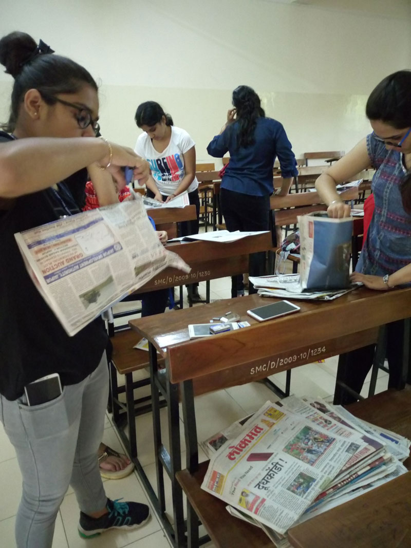 Green Guardians' Newspaper Bag-making Activity in progress